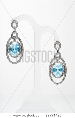 earrings with blue stones on the white