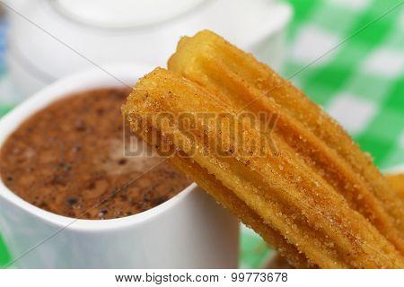 Spanish churro and hot chocolate, closeup