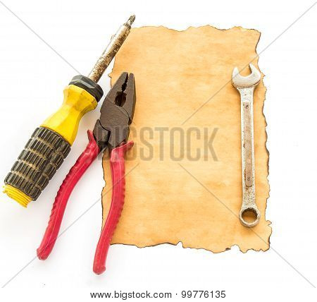 Tools And Old Paper On White Background