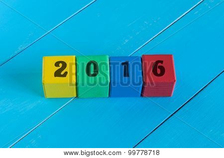 Numeral 2016 year on children's colourful cubes or blocks.