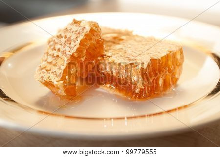 Stacks Of Honey Comb On A Plate On Wooden Table