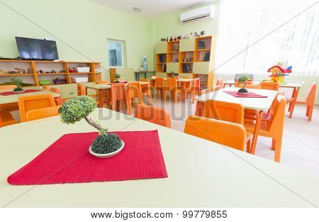 Kindergarten Classroom With Small Chairs And Tables
