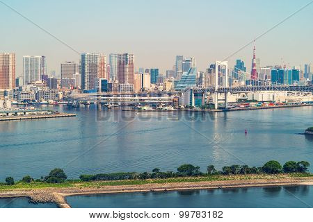 Tokyo Bay With A View Of The Rainbow Bridge And The Tokyo Skyline