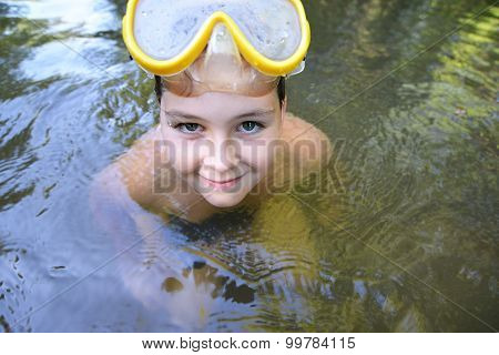 Boy Teenager Swims In  River In Summer