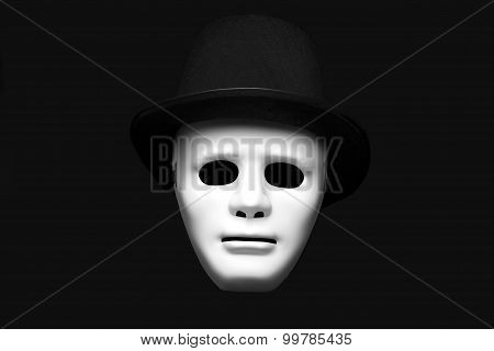 White mask in cylinder hat
