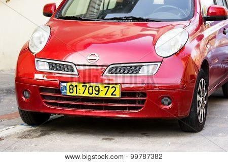 Tel - Aviv, Israel - March 29, 2015: Red Nissan Micra parked in Tel - Aviv.