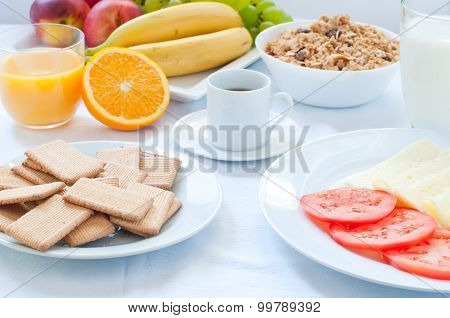 Continental breakfast with fruit coffee cheese vegetables