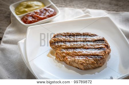 Beef Steak On The White Square Plate