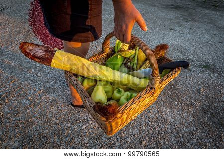 woman carying a waved food basket