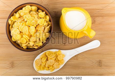 Bowl With Corn Flakes, Jug Of Milk And Plastic Spoon