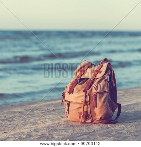 Travel Backpack On Summer Sea Beach.