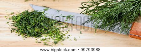 Chopped fresh ecological dill on the cutting board