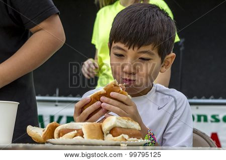 Mouth Full Of Hot Dog.