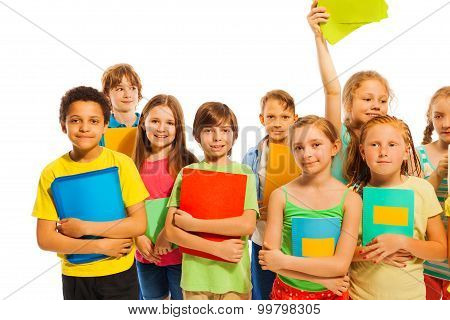 Classmates standing together with textbooks