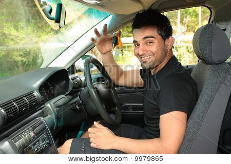 Happy Male Driver Holding Car Keys