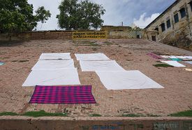 picture of gang  - Traditional clothing dried in the sun at Ganges riverbank Varanasi India - JPG