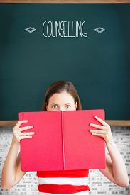 picture of counseling  - The word counselling and student holding book over face against teal - JPG