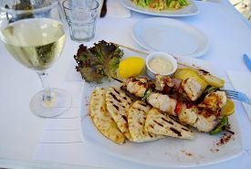 picture of souvlaki  - Chicken souvlaki with pita bread traditional greek cuisine - JPG