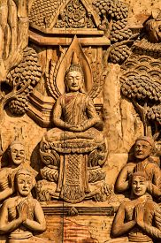 image of mural  - Murals wood carvings a Buddhist temple in Thailand - JPG