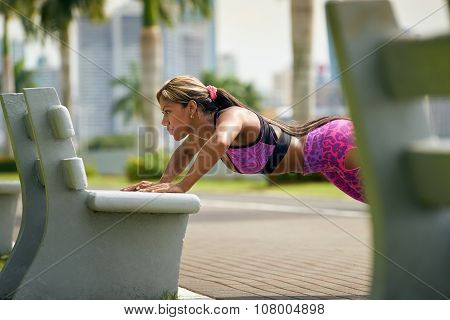 Woman Training Pectorals Doing Pushups On Street Bench-2
