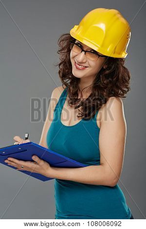 Woman Engineer With Protection Helmet And Folder
