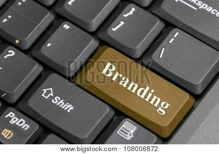 Brown branding key on keyboard