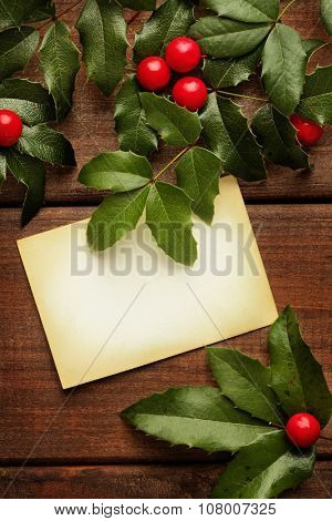 Christmas frame for greeting card with holly twigs