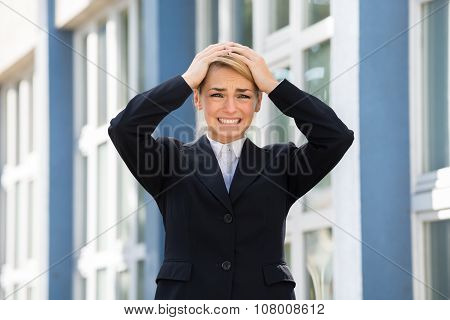 Sad Businesswoman With Hands On Head