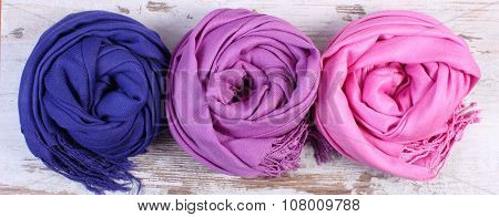 Colorful Scarves On Old Rustic Wooden Background