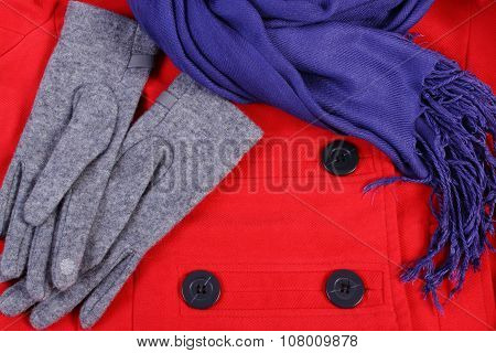 Woolen Gloves And Shawl For Woman On Red Coat Background