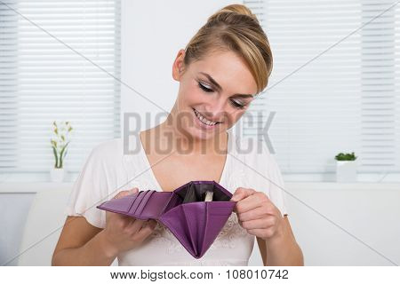 Woman Looking At Money In Purse
