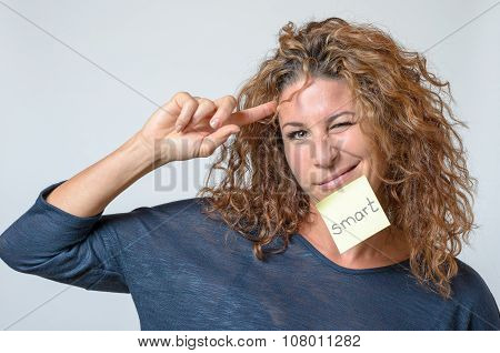 Young Woman With A Sticky Note In Her Face