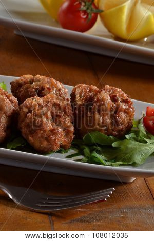Fried meat balls filled with cheese dish.