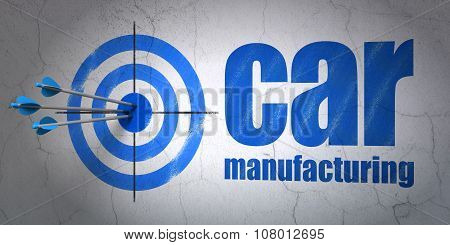 Industry concept: target and Car Manufacturing on wall background