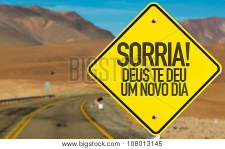 Smile! God Gives You Another Day (in Portuguese) sign on desert road