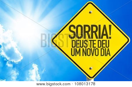 Smile! God Gives You Another Day (in Portuguese) sign with sky background