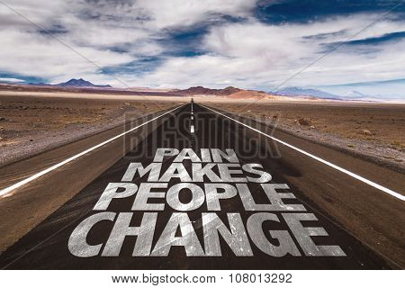 Pain Makes People Change written on desert road