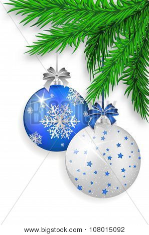 Blue And Silver Christmas Balls Hanging On Spruce Twig