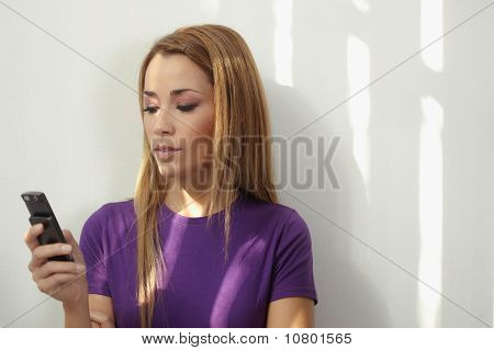 Woman Typing Text Message On Telephone