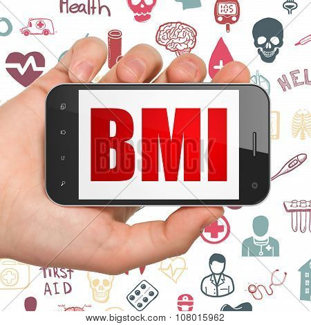 Medicine concept: Hand Holding Smartphone with BMI on display