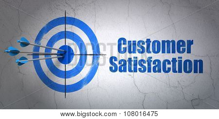 Marketing concept: target and Customer Satisfaction on wall background