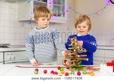 Two Little Kid Boys Decorating Christmas Tree