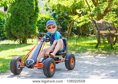 Active Cute Boy Having Fun With Toy Race Cars