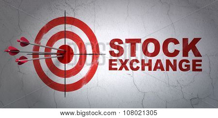 Business concept: target and Stock Exchange on wall background