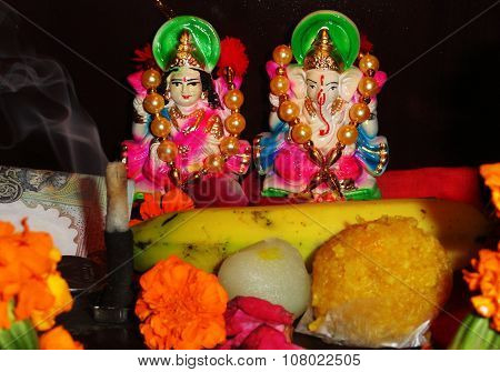 Devotional Goddess Maa Lakshmi and Lord Ganesha Statue with Some Sweets and Fruits