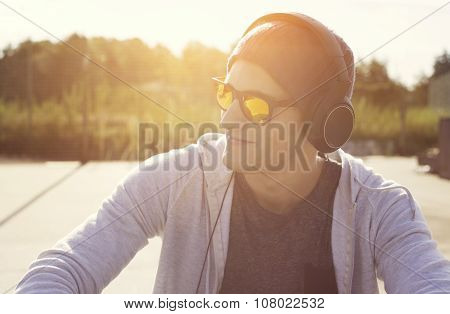 music addicted. young man listening songs with headphones