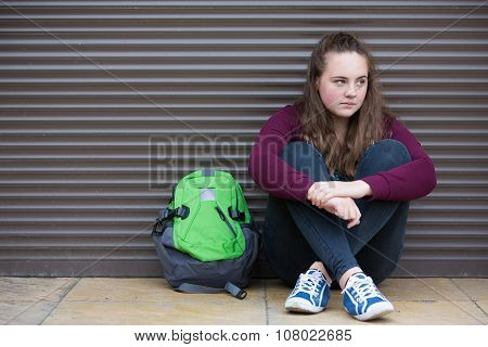 Homeless Teenage Girl On Streets With Rucksack