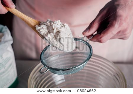 Man Sifting Flour For Pizza Dough