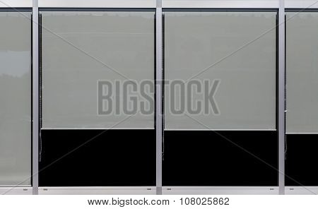 Window glass frame and plastic window blind at building wall