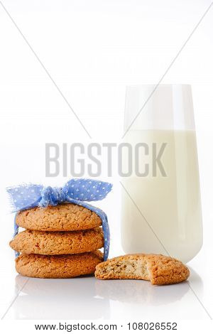 Stack of three homemade oatmeal cookies tied with blue ribbon in small white polka dots bitten cooki